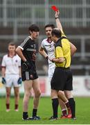 15 October 2017; Eugene Branagan of Kilcoo, left, is shown a red card by referee Niall Cullen during the AIB Ulster GAA Football Senior Club Championship First Round match between Kilcoo and Slaughtneil at Páirc Esler in Down. Photo by Seb Daly/Sportsfile