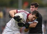 15 October 2017; Shane McGuigan of Slaughtneil in action against Darryl Branagan of Kilcoo during the AIB Ulster GAA Football Senior Club Championship First Round match between Kilcoo and Slaughtneil at Páirc Esler in Down. Photo by Seb Daly/Sportsfile