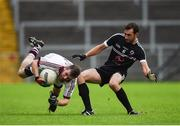 15 October 2017; Francis McEldowney of Slaughtneil in action against Aidan Branagan of Kilcoo, during the AIB Ulster GAA Football Senior Club Championship First Round match between Kilcoo and Slaughtneil at Páirc Esler in Down. Photo by Seb Daly/Sportsfile