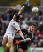 15 October 2017; Se McGuigan of Slaughtneil in action against Gary McEvoy of Kilcoo, during the AIB Ulster GAA Football Senior Club Championship First Round match between Kilcoo and Slaughtneil at Páirc Esler in Down. Photo by Seb Daly/Sportsfile