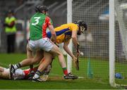 15 October 2017; Shane Golden of Sixmilebridge is tackled, in front of the goal line by the Clooney Quin goalkeeper Keith Hogan and full back Shane McNamara, resulting in a penalty being awarded, during the Clare County Senior Hurling Championship Final match between Clooney Quin and Sixmilebridge at Cusack Park in Ennis County Clare. Photo by Ray McManus/Sportsfile