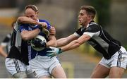 15 October 2017; David McCague of Scotstown in action against Michael Metzger and Gavin Doogan of Magheracloone, during the Monaghan County Senior Football Championship Final match between Magheracloone and Scotstown at St Tiernach's Park in Monaghan. Photo by Philip Fitzpatrick/Sportsfile