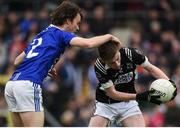 15 October 2017; Paul McArdle of Magheracloone in action against Fergal McPhillips of Scotstown, during the Monaghan County Senior Football Championship Final match between Magheracloone and Scotstown at St Tiernach's Park in Monaghan. Photo by Philip Fitzpatrick/Sportsfile
