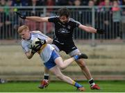 15 October 2017; Peter Og McCartan of Errigal Ciaran in action against Joe McMahon of Omagh St Enda's during the Tyrone County Senior Football Championship Final match between Errigal Ciaran and Omagh St Enda's at Healy Park in Tyrone. Photo by Oliver McVeigh/Sportsfile
