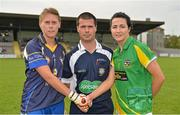 11 August 2012; Clare captain Emma O'Driscoll, left, shakes hands with Meath captain Katie O'Brien across referee Sean Joy before the game. TG4 All-Ireland Ladies Football Senior Championship Qualifier Round 2, Clare v Meath, St. Brendan's Park, Birr, Co. Offaly. Picture credit: Barry Cregg / SPORTSFILE