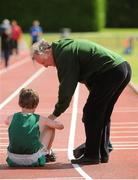 28 July 2012; Dylan Kearns, Killybegs A.C., Co. Donegal, and his grandfather and coach Bernie O'Callaghan, after competing in the Boy's Under-14 2,000m Walk event. Woodie's DIY Juvenile Track and Field Championships of Ireland, Tullamore Harriers Stadium, Tullamore, Co. Offaly. Picture credit: Tomas Greally / SPORTSFILE