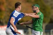 21 October 2017; Seán Finn of Ireland tangles with Barry MacDonald of Scotland during the U21 Shinty International match between Ireland and Scotland at Bught Park in Inverness, Scotland. Photo by Piaras Ó Mídheach/Sportsfile