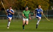 21 October 2017; Seán Finn of Ireland, gets away from Barry MacDonald, left, and Calum Shepherd of Scotland during the U21 Shinty International match between Ireland and Scotland at Bught Park in Inverness, Scotland. Photo by Piaras Ó Mídheach/Sportsfile