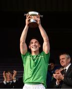 21 October 2017; Ireland captain Seán Finn lifts the cup after the U21 Shinty International match between Ireland and Scotland at Bught Park in Inverness, Scotland. Photo by Piaras Ó Mídheach/Sportsfile