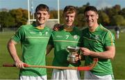 21 October 2017; Ireland's, from left, Patrick Curran, Cathal Dunbar and Seán Finn celebrate with the cup, after the U21 Shinty International match between Ireland and Scotland at Bught Park in Inverness, Scotland. Photo by Piaras Ó Mídheach/Sportsfile