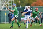 21 October 2017; John McGrath of Ireland in action against Rory Kennedy of Scotland during the Shinty International match between Ireland and Scotland at Bught Park in Inverness, Scotland. Photo by Piaras Ó Mídheach/Sportsfile