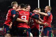 21 October 2017; Conor Murray of Munster (9) is congratulated by team-mates, including Chris Farrell, Ian Keatley and Keith Earls on scoring their side's first try during the European Rugby Champions Cup Pool 4 Round 2 match between Munster and Racing 92 at Thomond Park in Limerick. Photo by Brendan Moran/Sportsfile