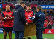 21 October 2017; Former Munster players and current Racing 92 player and coach Donnacha Ryan and Ronan O'Gara make a presentation to Munster captain Peter O'Mahony, to mark the first anniversary of the death of Munster coach Anthony Foley, before the European Rugby Champions Cup Pool 4 Round 2 match between Munster and Racing 92 at Thomond Park in Limerick. Photo by Brendan Moran/Sportsfile