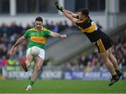 22 October 2017; Bryan Sheehan of South Kerry kicks a point despite the best efforts of John Payne of Dr. Crokes, during the Kerry County Senior Football Championship Final match between Dr. Crokes and South Kerry at Austin Stack Park, Tralee in Kerry. Photo by Brendan Moran/Sportsfile