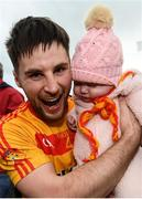 22 October 2017; Donie Newcombe of Castlebar Mitchels celebrates with his three-month-old neice Grace Malone following the Mayo County Senior Football Championship Final match between Ballintubber and Castlebar Mitchels at Elvery's MacHale Park in Castlebar, Mayo. Photo by Stephen McCarthy/Sportsfile
