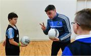 24 October 2017; Dublin footballer Paddy Andrews was in Holy Spirit BNS in Ballymun today at an AIG Heroes event with pupils, Carl Dunne, 12, left, and Jamie Masterson, 10, both from Ballymun. The AIG Heroes initiative is a programme that leverages AIG's sporting sponsorships to help provide positive role models and build confidence for young people in local communities. Photo by Sam Barnes/Sportsfile