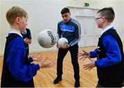 24 October 2017; Dublin footballer Paddy Andrews was in Holy Spirit BNS in Ballymun today at an AIG Heroes event with pupils, Corban Murphy, 10, left, and Jamie Masterson, 10, both from Ballymun. The AIG Heroes initiative is a programme that leverages AIG's sporting sponsorships to help provide positive role models and build confidence for young people in local communities. Photo by Sam Barnes/Sportsfile