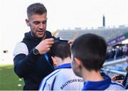 27 October 2017; Dublin footballer Jonny Cooper hands out the medals, after Ballyroan BNS won the Corn Kitterick shield during day 3 of the Allianz Cumann na mBunscol Finals at Croke Park, in Dublin. Photo by David Fitzgerald/Sportsfile