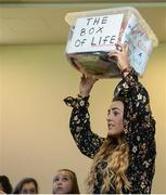 """28 October 2017; Orlagh Farmer, Cork Ladies Footballer, lifts up """"The Box of Life"""" during a group session entitled """"Getting The Right Balance: Juggling Demands As A Youth Player"""" at the #GAAyouth Forum 2017 at Croke Park in Dublin. Photo by Cody Glenn/Sportsfile"""
