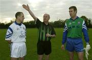 30 October 2002; Referee Senan Finucane indicates which way the teams will play in front of captains John Keane, left, Garda, and Damian Tucker, PSNI, before a representative Gaelic Football match between the two law enforcement agencies at the Westmanstown Sports Centre, Westmanstown, Co. Dublin. Picture credit; Brendan Moran / SPORTSFILE *EDI*