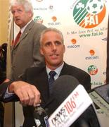 5 November 2002; Republic of Ireland Manager Mick McCarthy arriving at a press conference with FAI President Milo Corcoran, back, at which McCarthy's departure as manager of the Republic of Ireland team was announced. Soccer. Picture credit; David Maher / SPORTSFILE *EDI*