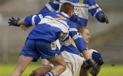 24 November 2002; Peter Loughran, Errigal Ciaran, is tackled by Darren Crozier, Ballinderry, Errigal Ciaran v Ballinderry, Ulster Club Semi Final, St Tighearnachs Park, Clones, Co. Monaghan. Picture credit; Damien Eagers / SPORTSFILE *EDI*