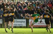 29 October 2017; Jack Kennedy of Clonmel Commercials scoring a point for his side despite the efforts of John Payne, left and Michael Moloney of Dr. Crokes during the AIB Munster GAA Football Senior Club Championship Quarter-Final match between Clonmel Commercials and Dr. Crokes at Clonmel Sportsfield, Clonmel in Tipperary. Photo by Eóin Noonan/Sportsfile