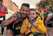 29 October 2017; Mark Lacey, left, and James Casserly, both from Lucan, after finishing the SSE Airtricity Dublin Marathon 2017 in Dublin City. 20,000 runners took to the Fitzwilliam Square start line to participate in the 38th running of the SSE Airtricity Dublin Marathon, making it the fifth largest marathon in Europe. Photo by Tomás Greally/Sportsfile