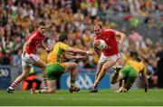 26 August 2012; Alan O'Connor, Cork, supported by Eoin Cadogan, in action against, left, Michael Murphy, and Colm McFadden, Donegal. GAA Football All-Ireland Senior Championship Semi-Final, Cork v Donegal, Croke Park, Dublin. Picture credit: Tomas Greally / SPORTSFILE