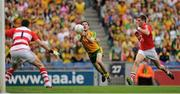 26 August 2012; Donegal's Mark Mc Hugh scores a point against goalkeeper Alan Quirke and, right, Eoin Cadogan, Cork. GAA Football All-Ireland Senior Championship Semi-Final, Cork v Donegal, Croke Park, Dublin. Picture credit: Tomas Greally / SPORTSFILE