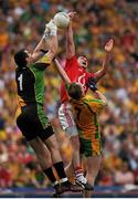 26 August 2012; Donncha O' Connor, Cork, in action against, left, Paul Durcan, and Anthony Thompson, Donegal. GAA Football All-Ireland Senior Championship Semi-Final, Cork v Donegal, Croke Park, Dublin. Picture credit: Tomas Greally / SPORTSFILE