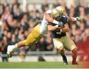 1 September 2012; Bo Snelson, Navy, is tackled by Zeke Motta , Notre Dame. NCAA Emerald Isle Classic, Navy v Notre Dame, Aviva Stadium, Lansdowne Road, Dublin. Picture credit: Pat Murphy / SPORTSFILE