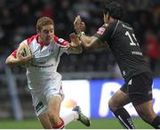 8 September 2012; Paddy Jackson, Ulster, is tackled by George Stowers, Ospreys. Celtic League, Round 2, Ospreys v Ulster, Liberty Stadium, Swansea, Wales. Picture credit: Steve Pope / SPORTSFILE