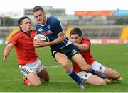 12 September 2012; James McCormack, Leinster, goes over for a try despite the tackle of Greg O'Shea, left, and Edward O'Keefe, Munster. Under 18 Schools Interprovincial, Munster v Leinster, Thomond Park, Limerick. Picture credit: Stephen McCarthy / SPORTSFILE