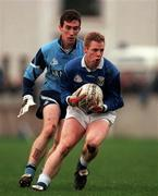 Cavan's Anthony Forde holds possession despite the attentions of Dublin's Paddy Christie at Parnell Park. 30/11/97. Photograph: Ray McManus SPORTSFILE.