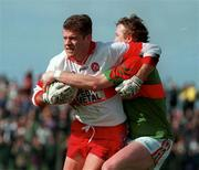 National Football League Quarter Final, Derry v Mayo, Markievicz Park, Sligo, 5/4/98. Anthony Tohill, Derry holds off the chalenge of Mayo's Pat Fallon. Photograph © Damien Eagers SPORTSFILE.