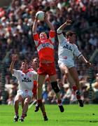 30 April 1995; Brian McGilligan of Derry contests a high-ball against Fergal Logan of Tyrone during the Church & General National Football League semi-final match between Derry and Tyrone at Croke Park in Dublin. Photo by Ray McManus/Sportsfile