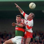 National Football League Quarter Final, Derry v Mayo, Markievicz Park, Sligo, 5/4/98. Johnny McGurk, Derry goes up for a high ball ahead of Mayo's Colm McManamon. Photograph © David Maher SPORTSFILE.