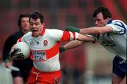 NFL Semi Final, Croke Park, Derry  V Monaghan,12/4/98, Action Features Joe Brolly (Derry) tackled by Noel Marron (Monaghan). Photograph © Ray McManus SPORTSFILE