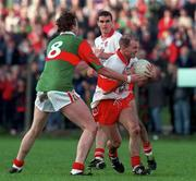 National Football League Quarter Final, Derry v Mayo, Markievicz Park, Sligo, 5/4/98. Johnny McGurk, Derry holds off the challenge of Mayo's Pat Fallon (8). Photograph © David Maher SPORTSFILE.