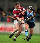 National Hurling League Division 1A, Dublin v Galway, Parnell Park. 8/3/98. Galway's Liam Burke, left, in a tussle for possession with Dublin's David Sweeney. Photograph © Brendan Moran SPORTSFILE.