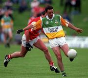 Martin Daly, Offaly, in action v Louth's Seamus O'Hanlon during the 1996 Leinster Football Championship. Photograph Brendan Moran SPORTSFILE