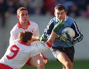 1 November 1998: Paul Croft of Dublin in action against Fergal Logan of Tyrone during the Church & General National League Football match between Dublin and Tyrone at Parnell Park in Dublin. Photo by Ray McManus/Sportsfile