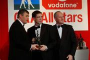 29 November 2002; Kieran McGeeney, Armagh, is presented with his All-Star award by GAA President Sean McCague and Paul Donovan, Chief Executive, Vodafone, at the VODAFONE GAA All-Star Awards in the Citywest Hotel, Dublin. Football. Hurling. Picture credit; Ray McManus / SPORTSFILE *EDI*