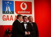 29 November 2002; Aidan O'Rourke, Armagh, is presented with his All-Star award by GAA President Sean McCague and Paul Donovan, Chief Executive, Vodafone, at the VODAFONE GAA All-Star Awards in the Citywest Hotel, Dublin. Football. Hurling. Picture credit; Ray McManus / SPORTSFILE *EDI*