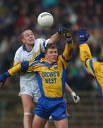 1 December 2002; Peter Loughran, Errigal Ciaran, contests a high ball with Paul Brewster, Enniskillen. Errigal Ciaran v Enniskillen, Ulster Club Football Final, St. Tighearnachs Park, Clones, Co. Monaghan. Football. Picture credit; Damien Eagers / SPORTSFILE *EDI*