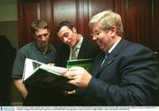 2 December 2002; Dublin footballer Ray Cosgrove, Armagh captain Kieran McGeeney, left, and SPORTSFILE photographer Ray McManus, right, pictured at the launch of 'A Season of Sundays 2002', a collection of Images of the 2002 Gaelic Games year by the SPORTSFILE photographers, in the Westin Hotel, Dublin. Picture credit; David Maher / SPORTSFILE