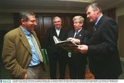 2 December 2002; Pictured at the launch of 'A Season of Sundays 2002', a collection of Images of the 2002 Gaelic Games year by the SPORTSFILE photographers, are from left, Ard Stiurthoir Liam Mulvihill, Armagh Manager Joe Kernan, SPORTSFILE photographer Ray McManus and GAA President Sean McCague, in the Westin Hotel, Dublin. Picture credit; David Maher / SPORTSFILE