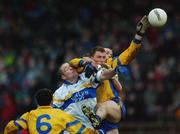 1 December 2002; Peter Loughran and Pascal Canavan, Errigal Ciaran, contest a high ball with Paul Brewster, Enniskillen. Errigal Ciaran v Enniskillen, Ulster Club Football Final, St Tighearnachs Park, Clones, Co. Monaghan. Picture credit; Damien Eagers / SPORTSFILE *EDI*