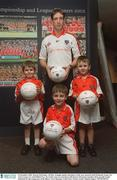 16 December 2002; Kieran McGeeney, All Star Armagh captain and player of the year pictured with Donnacha Tynan, (5), Aaron Tynan, (7), and Killiian Fox, (5), Gaelic Gear in association with Kieran McGeeney launches their juvenile Gaelic collection for the young stars of the future, GAA Museum, Croke Park. Picture credit; Damien Eagers / SPORTSFILE
